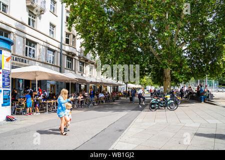 Stuttgart, Germany, August 16, 2019, Crowd of people enjoying summertime in inner city of stuttgart at famous marienplatz square where restaurants and - Stock Photo