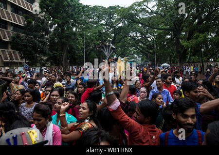 DHAKA, BANGLADESH - AUGUST 23 : Hindu devotees parade as they take part in the celebrations of Janmashtami, a festival marking the birth of Hindu deit - Stock Photo