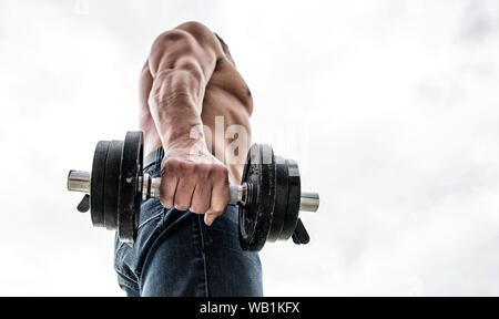 athletic body. Dumbbell gym. Muscular man exercising in morning with barbell. fitness and sport equipment. Healthy lifestyle. athletic man sportsman weightlifting. steroids. copy space. - Stock Photo