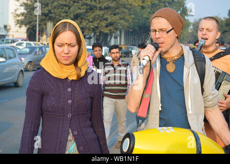 Iskcon temple devotees singing of hymns in praise of Lord krishna at connaught Place - Stock Photo