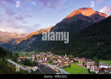 Aerial view of the town of Feichten in the Kaunertal valley (austrian alps) at sunset - Stock Photo