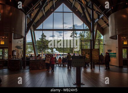 Old Faithful, Wyoming / USA - 10-02-2016 : Vistiors gather information at the Old Faithful Visitors Center in Yellowstone National Park - Stock Photo