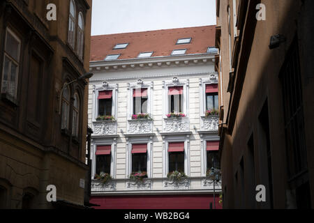Budapest, Hungary - Aug 16, 2019: A beaurifully renovated building facade in Budapest, Hungary - Stock Photo