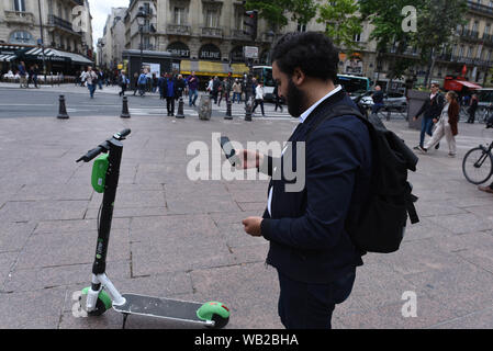 *** STRICTLY NO SALES TO FRENCH MEDIA OR PUBLISHERS *** June 12, 2019 - Paris, France: A 28yo law student is using an electric scooter to go to a university library near the Sorbonne University. Some streets and squares in Paris have been swamped by e-scooters, known as 'trottinettes electriques' in French, prompting calls for government regulation. - Stock Photo