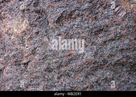 The structure of red and black granite. The texture of natural stone. Creative vintage background - Stock Photo