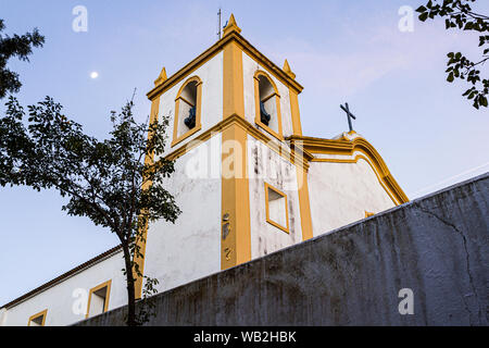 Bell tower of Nossa Senhora da Imaculada Conceicao Church, at Lagoa da Conceicao neighborhood, built in 1751. Florianopolis, Santa Catarina, Brazil. - Stock Photo