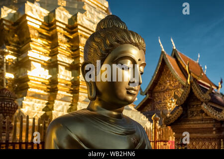 Golden Buddha statue in Wat Phrathat Doi Suthep temple in Chiang Mai - Stock Photo