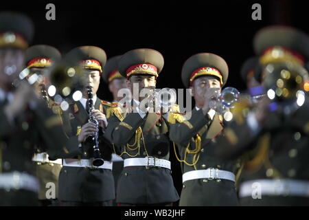 Moscow, Russia. 23rd Aug, 2019. MOSCOW, RUSSIA - AUGUST 23, 2019: Members of the Military Band of the Korean People's Army of North Korea perform during the opening ceremony of the 12th Spasskaya Tower International Military Music Festival in Red Square. Artyom Geodakyan/TASS Credit: ITAR-TASS News Agency/Alamy Live News - Stock Photo