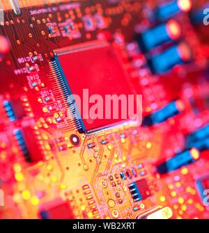 Electronic circuit board containing chips and components. - Stock Photo