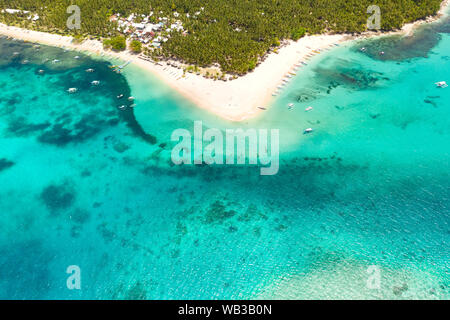 Beautiful tropical island in sunny weather, view from above. Daco island, Philippines. White sandy beach and turquoise lagoon.