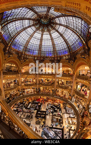 PARIS, FRANCE - August 16, 2019, Galeries Lafayette interior from top in Paris. People do shoping at department store. The architect Georges Chedanne - Stock Photo