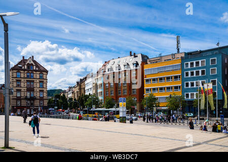 Stuttgart, Germany, August 16, 2019, Colorful facades of old houses surrounding marienplatz square in stuttgart city where many people enjoy hot summe - Stock Photo