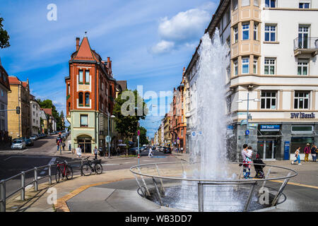 Stuttgart, Germany, August 16, 2019, Squirting fountain at marienplatz square in inner city of stuttgart where historical houses and cafes attract man - Stock Photo