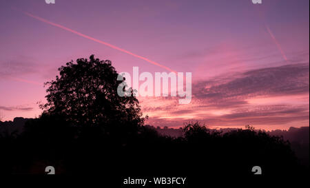 UK Weather Spectacular golden hour sunrise Time-Lapse over Wirksworth, Derbyshire at the start of a hot August day in the Derbyshire Dales, Peak District National Park - Stock Photo