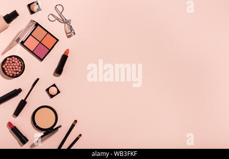 Different luxury make up cosmetics frame on pink background - Stock Photo
