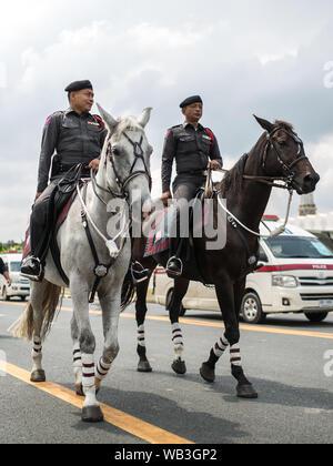BANGKOK, THAILAND - OCTOBER 27: Mounted Policemen patrolling area near the Grand Palace on October 27, 2016, Bangkok, Thailand. - Stock Photo