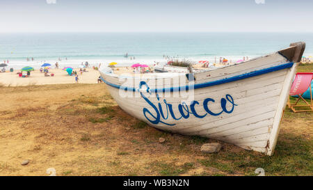 Old fishing boat advertising Sirocco Restaurant at Bolonia beach, Bolonia, Costa de la Luz, Cadiz Province, Andalusia, southern Spain.