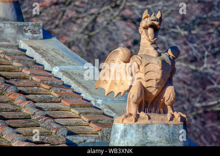 funny decorative dragon standing on the roof - Stock Photo