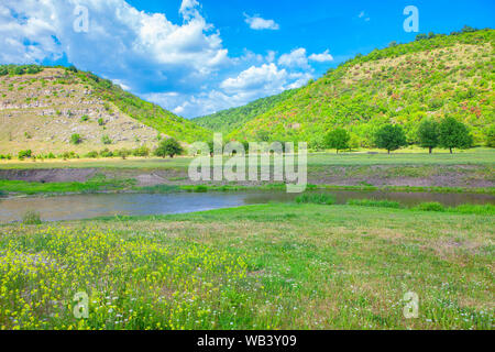landscape with little river and green hills - Stock Photo