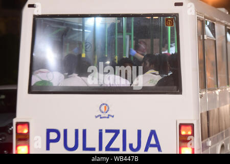Floriana, Malta. 23rd Aug, 2019. Migrants are taken away from the army base in Floriana, Malta, Aug. 23, 2019. The Maltese government confirmed that 356 migrants were brought to Malta Friday night on board of a patrol vessel of the Maltese Armed Forces (AFM) after they were transferred from the Norwegian-flagged charity ship Ocean Viking two weeks ago. Credit: Jonathan Borg/Xinhua Credit: Xinhua/Alamy Live News - Stock Photo