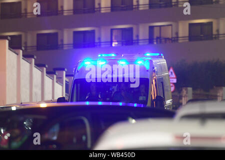 Floriana, Malta. 23rd Aug, 2019. An ambulance moves to the army's Hay Wharf base in Floriana, Malta, Aug. 23, 2019. The Maltese government confirmed that 356 migrants were brought to Malta Friday night on board of a patrol vessel of the Maltese Armed Forces (AFM) after they were transferred from the Norwegian-flagged charity ship Ocean Viking two weeks ago. Credit: Jonathan Borg/Xinhua Credit: Xinhua/Alamy Live News - Stock Photo