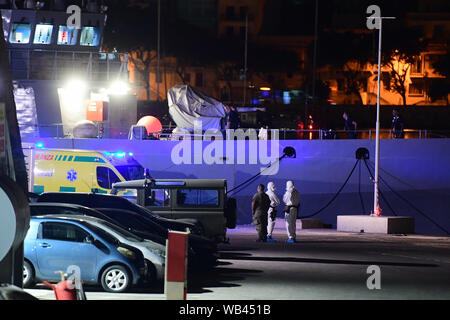 Floriana, Malta. 23rd Aug, 2019. The Armed Forces of Malta (AFM) patrol P61 docks at the army's Hay Wharf base in Floriana, Malta, Aug. 23, 2019. The Maltese government confirmed that 356 migrants were brought to Malta Friday night on board of a patrol vessel of the Maltese Armed Forces (AFM) after they were transferred from the Norwegian-flagged charity ship Ocean Viking two weeks ago. Credit: Jonathan Borg/Xinhua Credit: Xinhua/Alamy Live News - Stock Photo