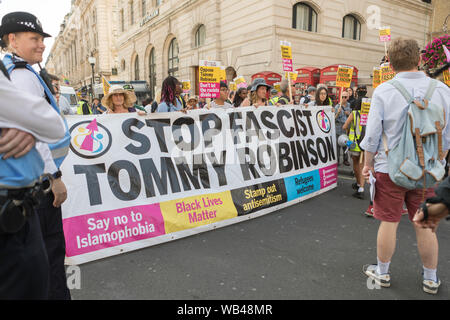 Portland Place, London, UK. 24th Aug, 2019. Free Tommy Robinson protest outside the BBC. At the same time a counter demonstration is taking place, organised by Stand Up To racism and Unite against fascism. Penelope Barritt/Alamy Live News - Stock Photo