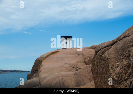 White house on a rock in Sweden - Stock Photo