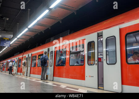 Doors opening on a Munich S-Bahn train at a platform in Munich, Bavaria, Germany. - Stock Photo