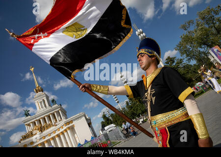 Moscow, Russia. 24th, August, 2019 Members of the Egyptian Military Symphonic Band during traditional marching of orchestras on the Main alley of VDNKh exhibition centre during the 12th Spasskaya Tower International Military Music Festival in Moscow - Stock Photo
