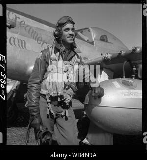 [Edward C. Gleed, Tuskegee pilot, standing, three-quarter length portrait]; Photograph shows Tuskegee airman Edward C. Gleed of Lawrence, KS, Class 42-K, Group Operations Officer. Includes P-5/D in background, Creamer's Dream, generally flown by Charles L. White, St. Louis, MO, Class 44-C. Ramitelli, Italy, March 1945. (Source: Tuskegee Airmen 332nd Fighter Group pilots.)