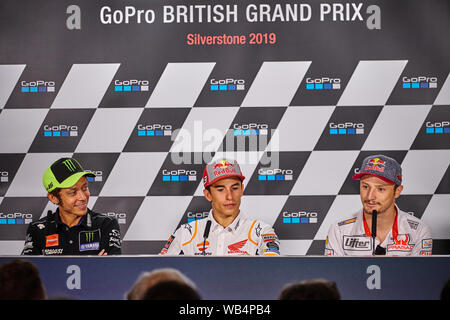Towcester, Northamptonshire, UK. 24th Aug, 2019. From Left to Right Valentino Rossi (ITA) Marc Marquez (SPA) and Jack Miller (AUS) during the 2019 GoPro British Grand Prix Moto GP at Silverstone Circuit. Credit: Gergo Toth/Alamy Live News - Stock Photo