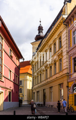 Sibiu, Romania - 2019. People wandering on the streets of Sibiu (old town). Streets with colorful houses. - Stock Photo