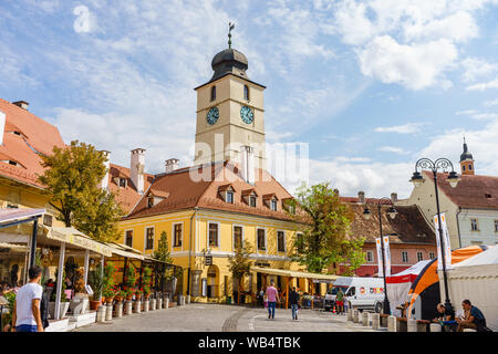 Sibiu, Romania - 2019. People wandering on the street of Sibiu near the Council Tower (Turnul Sfatului). - Stock Photo