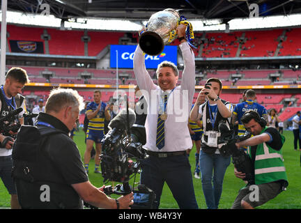 London, UK. 24th August 2019; Wembley Stadium, London, England; Rugby Football League Coral Challenge Cup final, Warrington Wolves versus St Helens; Warrington Wolves Head Coach, Steve Price, is surrounded by the media while lifting the Challenge Cup at Wembley - Editorial Use Only. Credit: Action Plus Sports Images/Alamy Live News - Stock Photo