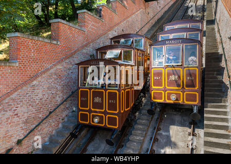 Funicular train with tourists going to Buda Castle in Budapest - Stock Photo
