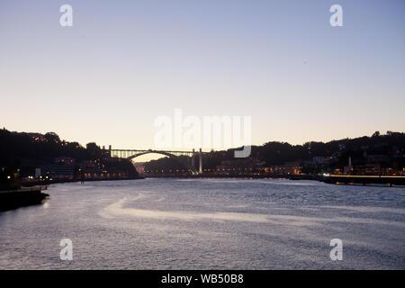The river Douro (Rio Douro) in Porto and the Arrábida Bridge (Ponte da Arrábida) in in the sunset light - Portugal. - Stock Photo