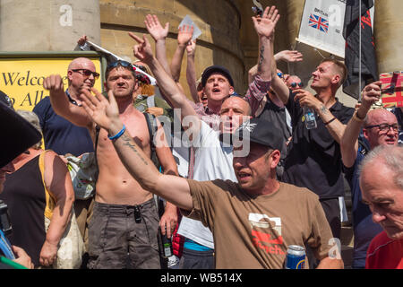 London, UK. 24th Aug, 2019. Tommy Robinson supporters protest at the BBC. They claim he is in jail for journalism. He was sentenced to 9 months for 3 offences outside Leeds Crown Court which could have led to the collapse of a grooming gang trial, and has previous convictions for violence, financial and immigration frauds, drug possession and public order offences. Police kept the two groups apart. Robinson supporters were later joined by marchers from Trafalgar Square, and a larger group from Stand Up to Racism came to join Antifa. Credit: Peter Marshall/Alamy Live News - Stock Photo