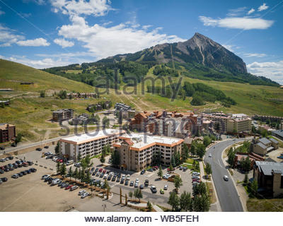 Buildings of the ski base area at Crested Butte Mountain Resort in Colorado on a summer day. - Stock Photo