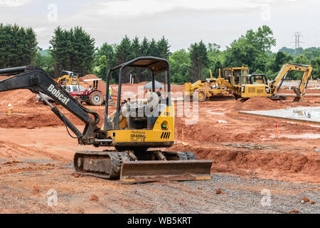 HICKORY, NC, USA-21 MAY 2019: Earth--moving machinery prepares building site for apartment complex. - Stock Photo