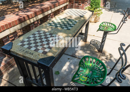 ASHEVILLE, NC, USA-10 JUNE 2018:  A permanent checker/chess table in Pritchard Park in downtown Asheville. - Stock Photo