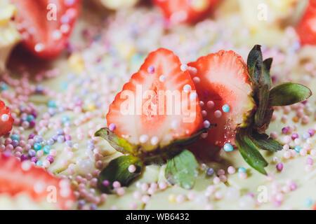 Vanilla ice cream cake with strawberry on top macro