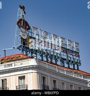 Madrid, Spain -July 22, 2019: Neon sign above Puerta del Sol public square - Stock Photo