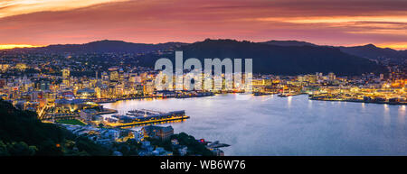 Wellington city and harbour seen at dusk from Mount Victoria. Wellington is the capital city of New Zealand. - Stock Photo