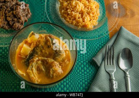Chiles rellenos in a soup with beans and Mexican rice, as part of mexican culinary traditions - Stock Photo