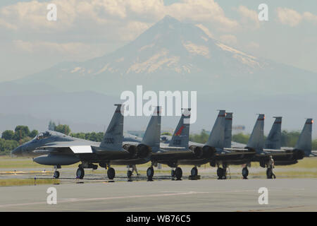Oregon Air National Guard F-15C Eagles, assigned to the 142nd Fighter Wing prepare for an afternoon training mission as part of dissimilar aircraft combat training (DACT) on Aug. 13, 2019, at the Portland Air National Guard Base, Ore. The Oregon Airmen are training with U.S. Navy F-18F Super Hornet from VFA-41 squadron, based out of Naval Air Station Lemoore, Calif., during two-weeks of DACT exercises. (Air National Guard photo by Master Sgt. John Hughel, 142nd Fighter Wing Public Affairs) - Stock Photo