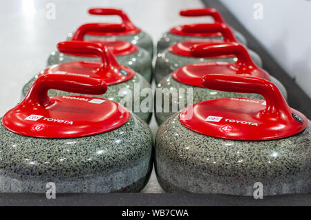 Raleigh, North Carolina, USA. 24th Aug, 2019. Aug. 24, 2019 Ã RALEIGH, N.C., US - Curling stones ready for action Curling Night in America at the Raleigh Ice Plex. Curling Night in America featured members of the U.S. Olympic menÃs gold medal team from the 2018 Winter Olympics in South Korea, the U.S. womenÃs team, as well as teams from Italy, Japan, and Scotland, Aug. 22-24, 2019. Credit: Timothy L. Hale/ZUMA Wire/Alamy Live News - Stock Photo