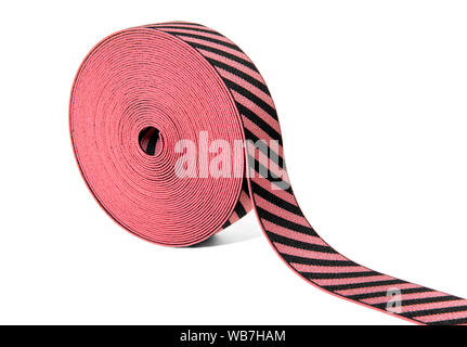 Roll of decorative elastic ribbon in red and black with alternating diagonal stripes displayed at an angle on white with copy space - Stock Photo