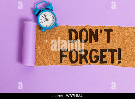 Writing note showing Don T Forget. Business concept for used to remind someone about important fact or detail - Stock Photo
