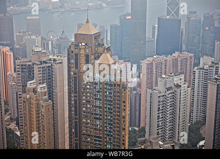 High-rise buildings in Central District as seen from Victoria Peak on a hazy day. Hong Kong, China. - Stock Photo